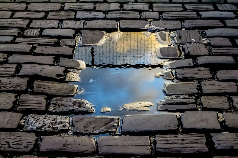 Puddle on a brick road